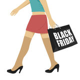 Female legs wearing black shoes walking with shopping bag with black friday text. Female legs wearing black shoes walking with a shopping bag with black friday Stock Photography
