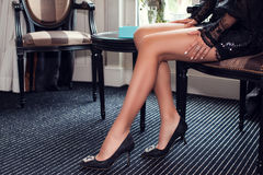 Female legs wearing high heels Royalty Free Stock Photos
