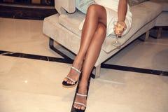 Female legs wearing high heels royalty free stock photos