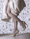 Female legs with wedding dress Royalty Free Stock Image