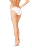 Female legs in white bikini panties Royalty Free Stock Photography