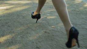 Female legs . Women Running In High Heels . stock video footage