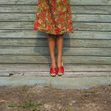 Female legs on wooden background Stock Photos