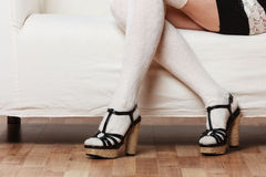 Female legs in woolen stockings heeled shoes Royalty Free Stock Photography