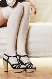 Female legs in woolen stockings heeled shoes Royalty Free Stock Images