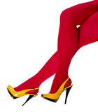 Female legs in yellow shoes and red tights Stock Images