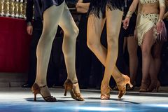 2 young girls dancing together. Female legs of young girls who dance in dance competition Stock Photo