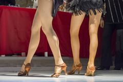 2 young girls dancing together. Female legs of young girls who dance in dance competition Royalty Free Stock Photography