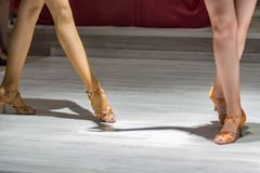 2 young girls dancing together. Female legs of young girls who dance in dance competition Stock Photography