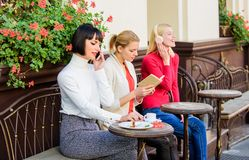 Female leisure. Weekend relax and leisure. Different interests. Hobby and leisure. Group pretty women cafe terrace stock image