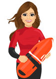 Female lifeguard holding a rescue can Royalty Free Stock Photos