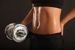 Female lifting a dumbbell Stock Photos