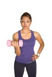 Female  lifting dumbell in one hand Royalty Free Stock Photography
