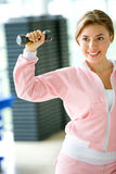 Female lifting free weights Royalty Free Stock Photos