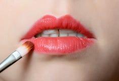 Female lips close up with lipstick. Brush Stock Photos