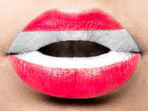 Female lips close up with a picture flag of Austria. white, red. Female lips close up with a picture of the flag of Austria. white, red stock images