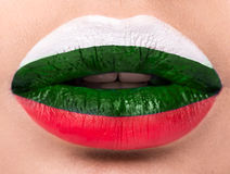 Female lips close up with a picture flag of Bulgaria. white, green, red. Stock Photography