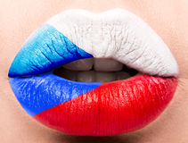 Female lips close up with a picture flag of Czech Republic. white, red, blue. Stock Photography