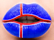 Female lips close up with a picture flag of Iceland. Blue, Red Cross. Royalty Free Stock Image
