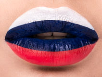 Female lips close up with a picture flag of Russia. Stock Photo