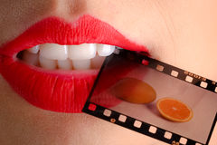 Female lips and film Royalty Free Stock Images