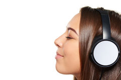 Female listening enjoying music in headphones with closed eyes Stock Photo