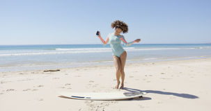Female listening music and dancing on beach Stock Photography
