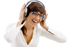 Female listening music with headphone Royalty Free Stock Photography
