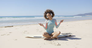Female listening music on sea background Stock Images