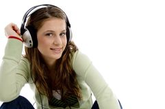 Female listening to music and looking at camera Stock Photo