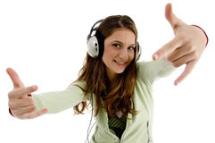 Female listening to music and showing hand gesture Stock Image