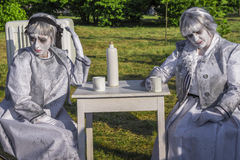 Female living statues Stock Images