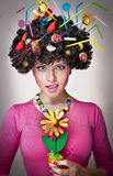 Female with lollipops in the hair royalty free stock photos