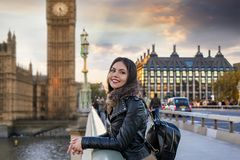Female London traveler enjoys the view to the Westminster Palace and Big Ben clocktower stock photos
