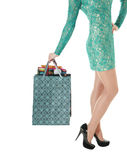 Female long legs in black shoes and shopping gift bags. Royalty Free Stock Image