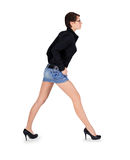 Female with long legs standing over white Stock Images