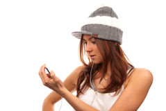 Female lookin at cell phone in headphones Stock Image