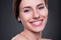 Female looking at camera and smiling Royalty Free Stock Image