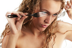 Female looking through forks Stock Image