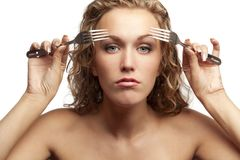 Female looking through forks Stock Photos