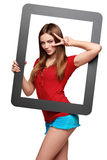 Female looking through the frame giving thumb up Stock Photo