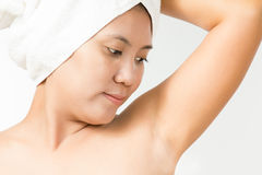 Female looking on her armpit Stock Photo