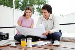 Female Looking At House Plan Royalty Free Stock Image