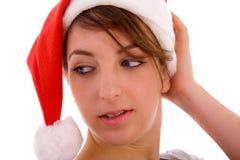 Female looking sideways wearing christmas hat Stock Image