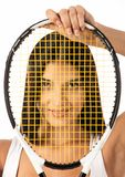 Female looking through strings of tennis racket Royalty Free Stock Photos