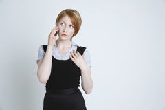 Female Looking Up While Using Cell Phone Royalty Free Stock Photo