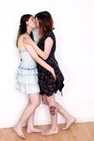 Female lovers kissing. Pair of beautiful girls showing affection with kissing Royalty Free Stock Photos