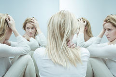 Female with low self esteem. Photo of troubled female with low self esteem stock images