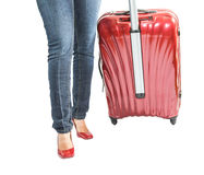 Female and Luggage Bag II. Female legs with red luggage bag over white background stock photos