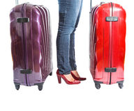 Female and Luggages II. Female legs with red luggage bag over white background stock images